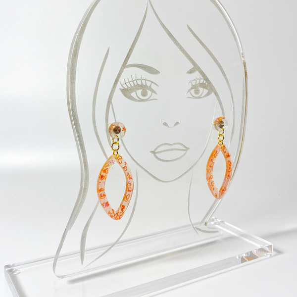 Acrylic display head with coral heart earrings