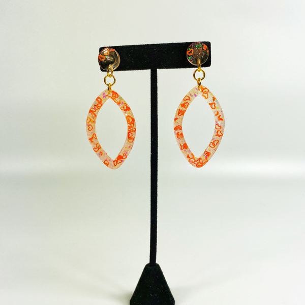 Earring stand with coral heart earrings