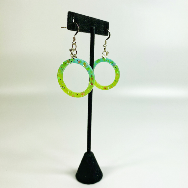 Green Hula Hoop Earrings on an earring display stand