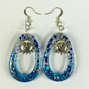 Blue oval hoop earrings sparkly with silver sun charm