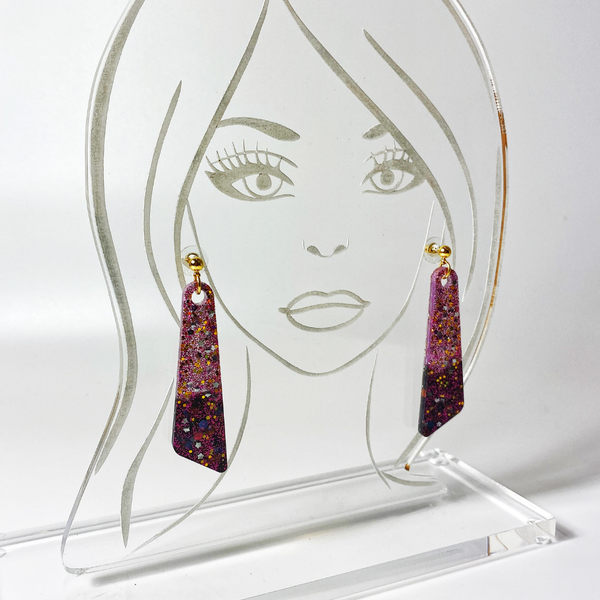 Batwing earrings shown on acrylic head model