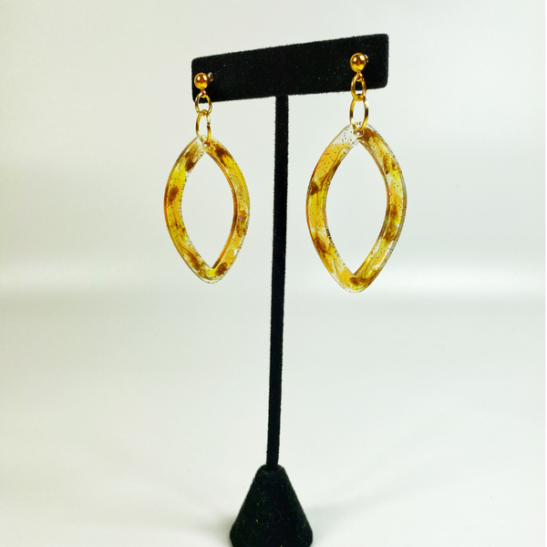 Tortoise Shell pointed hoop earrings on black earring display stand