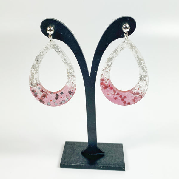 Scarlet and Grey Big Hoop earrings on black earring display stand