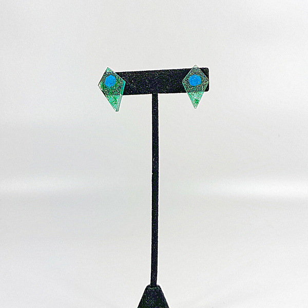 Jade kite studs on black earring display stand