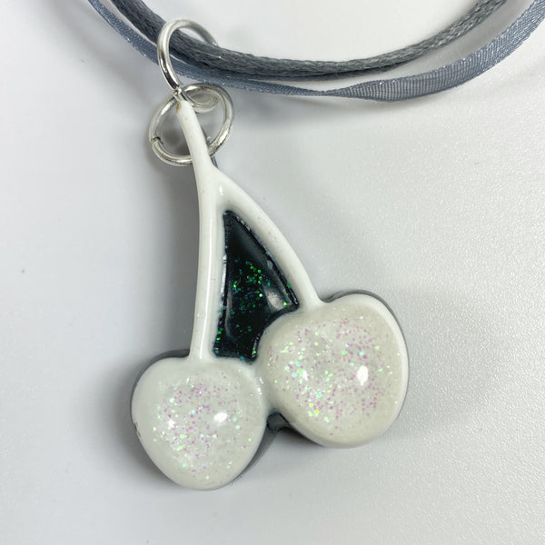 Iridescent White Cherries on Black Resin, Grey Necklace front view