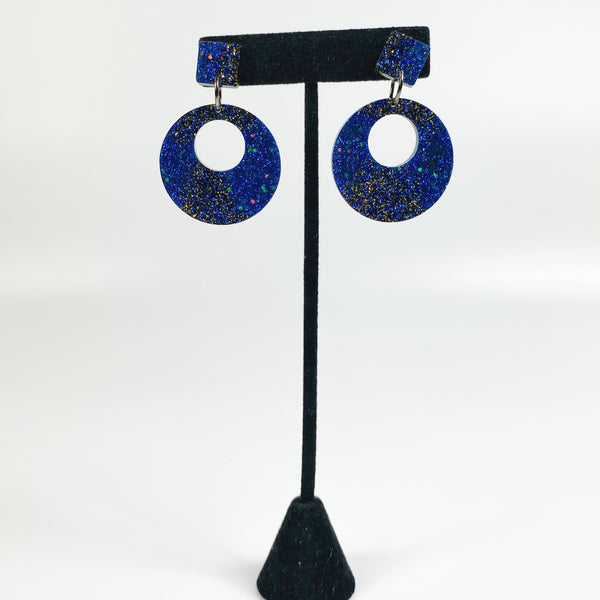 Asymmetrical Deep blue to black resin hoops on black earring stand