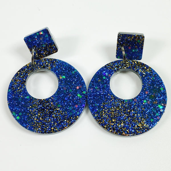 Asymmetrical Deep blue to black resin hoops, front view