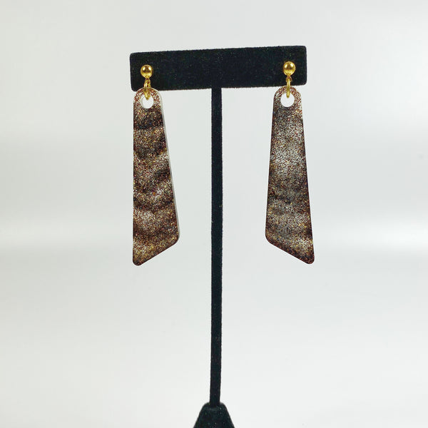 Black and Brown Sparkly Resin Dangle Earrings on black earring stand