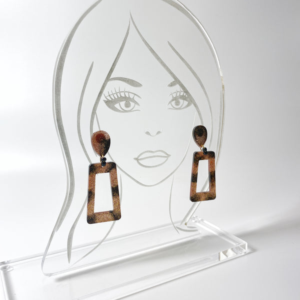 Brown and Black Striped Square Hoop Resin Earrings on acrylic display head
