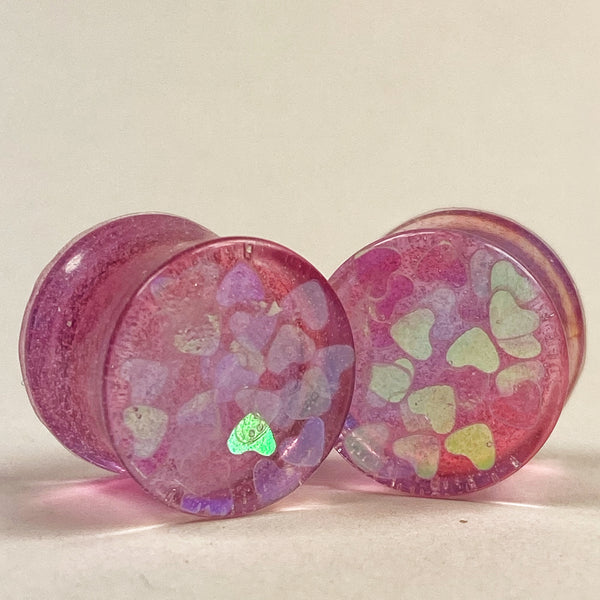 Gauge front, translucent pink resin with pink heart glitter