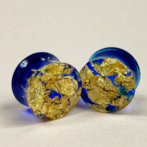 Gauge Front, gold flakes suspended in sapphire resin