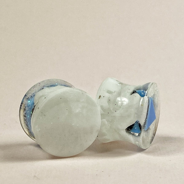 The backs of these gauges, cool white marble pattern