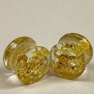 Gauge Front, gold flakes suspended in transparent resin
