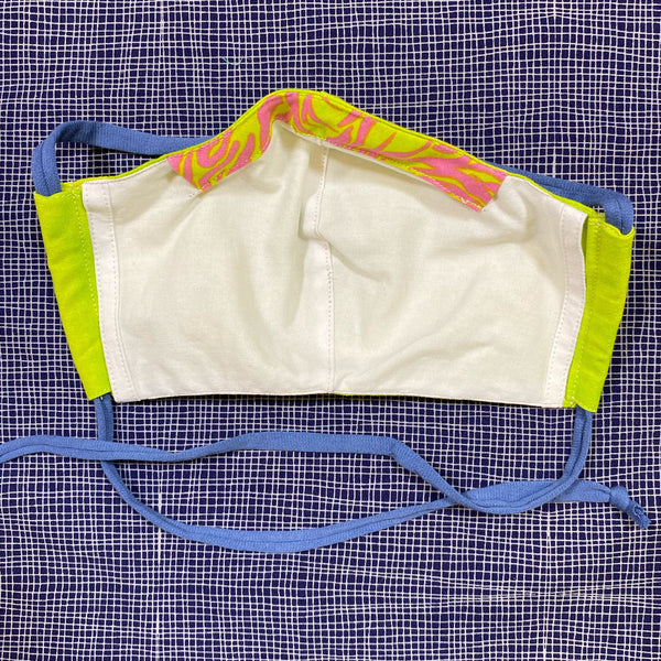 Inside of tie-dyed lime face mask, white cotton fabric with lime & hot pink nose wire channel