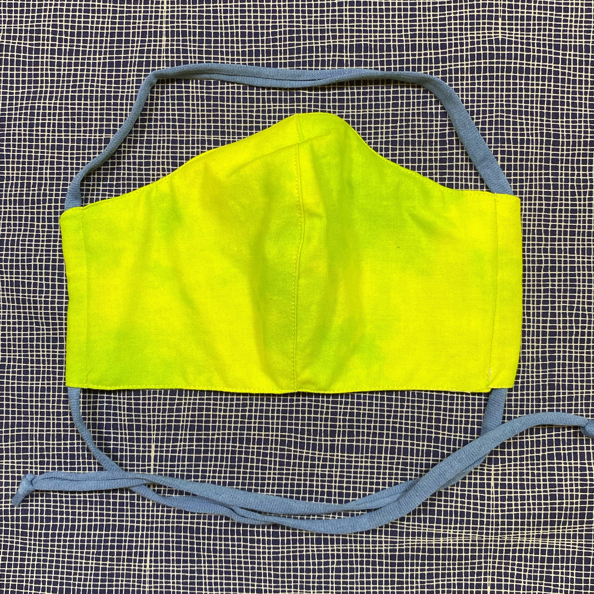 Front of tie-dyed lime face mask