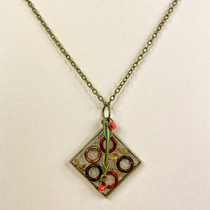 Medium view of square necklace on point with a bronze arrow charmarrow and targets