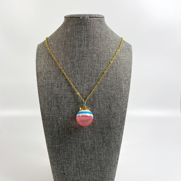 Bubblegum Cat Layered Colors Resin Necklace on grey tweed necklace display stand