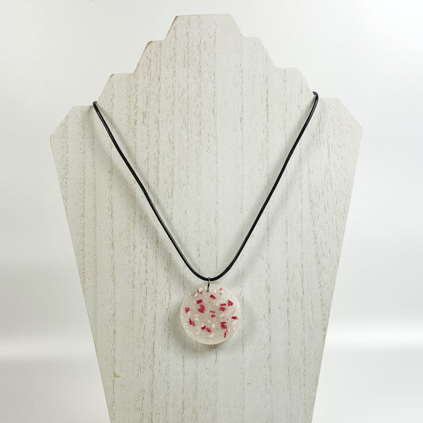 Red and White Terrazzo Resin Necklace on pale wood necklace stand