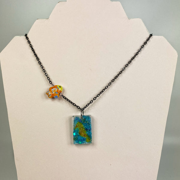 rectangular pendant, orange seahorse in aqua glitter, orange ceramic fish
