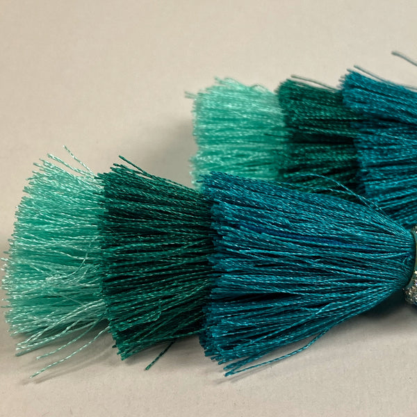 closeup of the three tassel layers, pale aqua, deep teal, turquoise