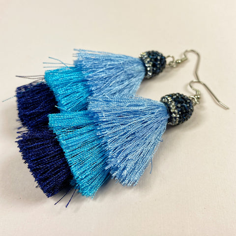 Three tiers of tassels in these earrings: blue over aqua over navy