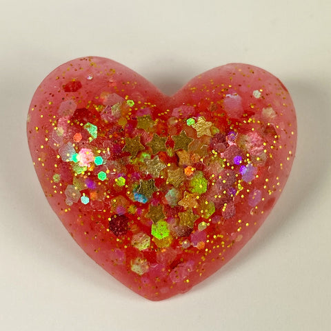 Pink resin heart with gold star and other glitter