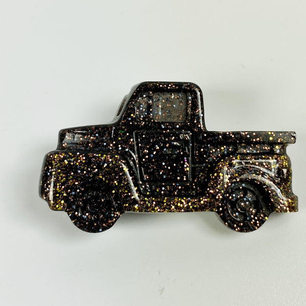 Front view of brown pickup pin