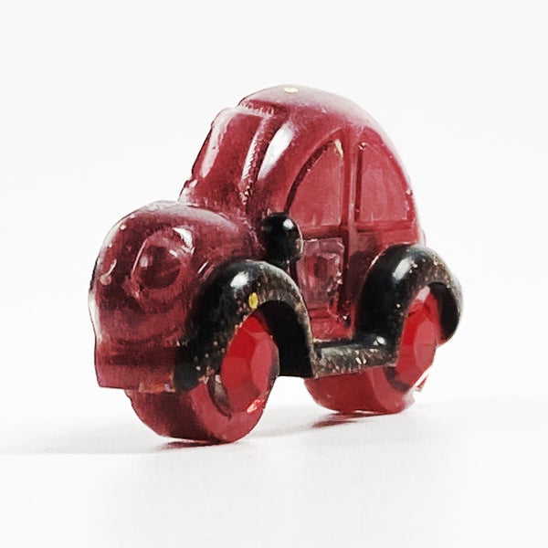 Red VW resin pin with ruby wheels, side view A