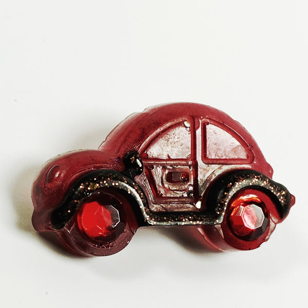 Red VW resin pin with ruby wheels, alternative front view