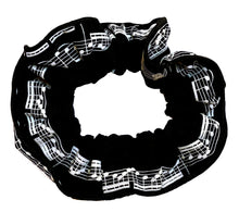 Load image into Gallery viewer, Musical hair tie scrunchie. White music score on black material.  Hand-made, large size (approx 15cm diameter)