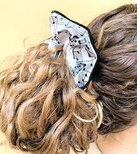 Load image into Gallery viewer, Musical hair tie scrunchie. Black music score on White material.  Hand-made, large size (approx 15cm diameter). Shown on model