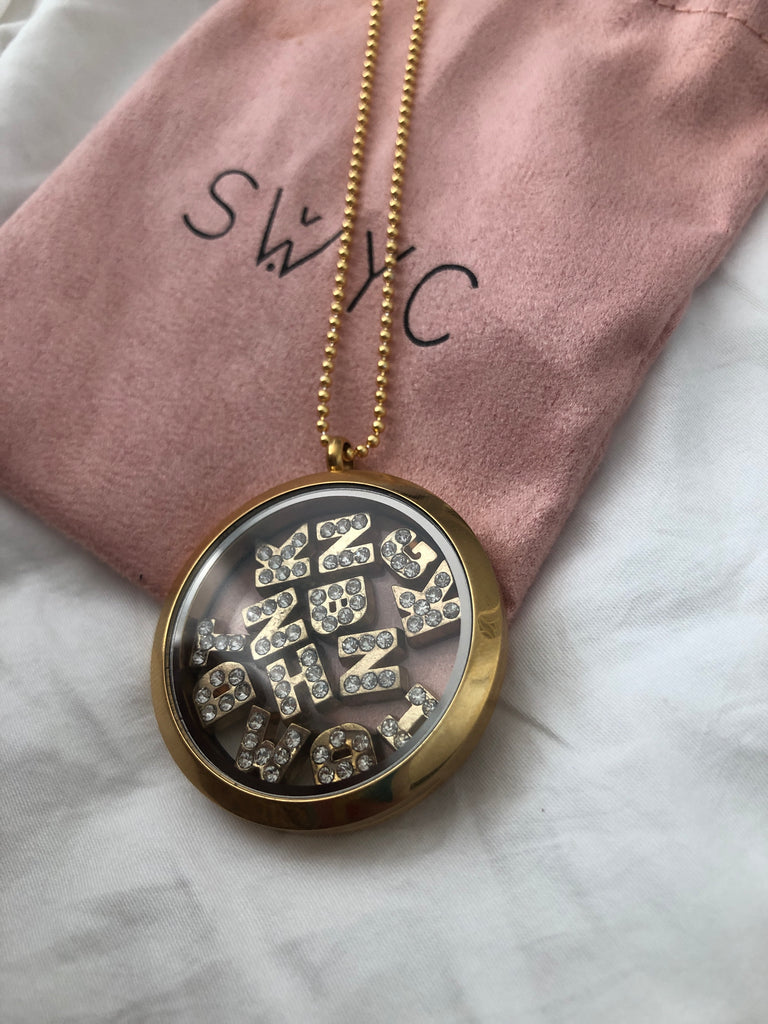LARGE ROUND LOCKET