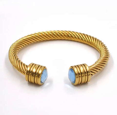 GOLD TWISTED BANGLE - BLUE STONE