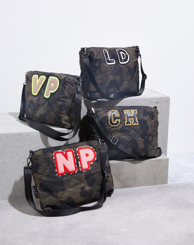 Camo print quilted messenger bag