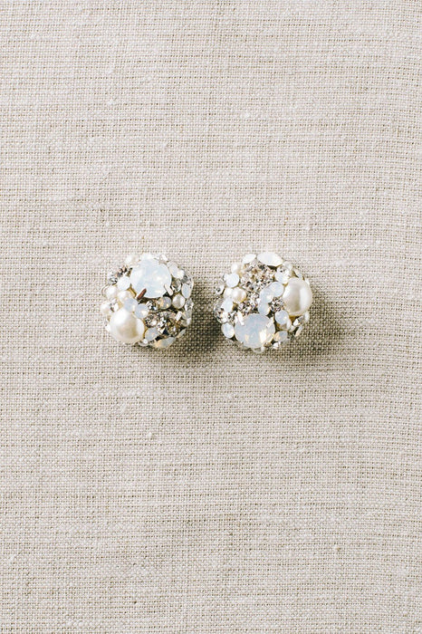 A pair of vintage-inspired dome-shaped stud earrings that use a mix of opal and clear Swarovski crystals and pale ivory pearls. Sara Gabriel