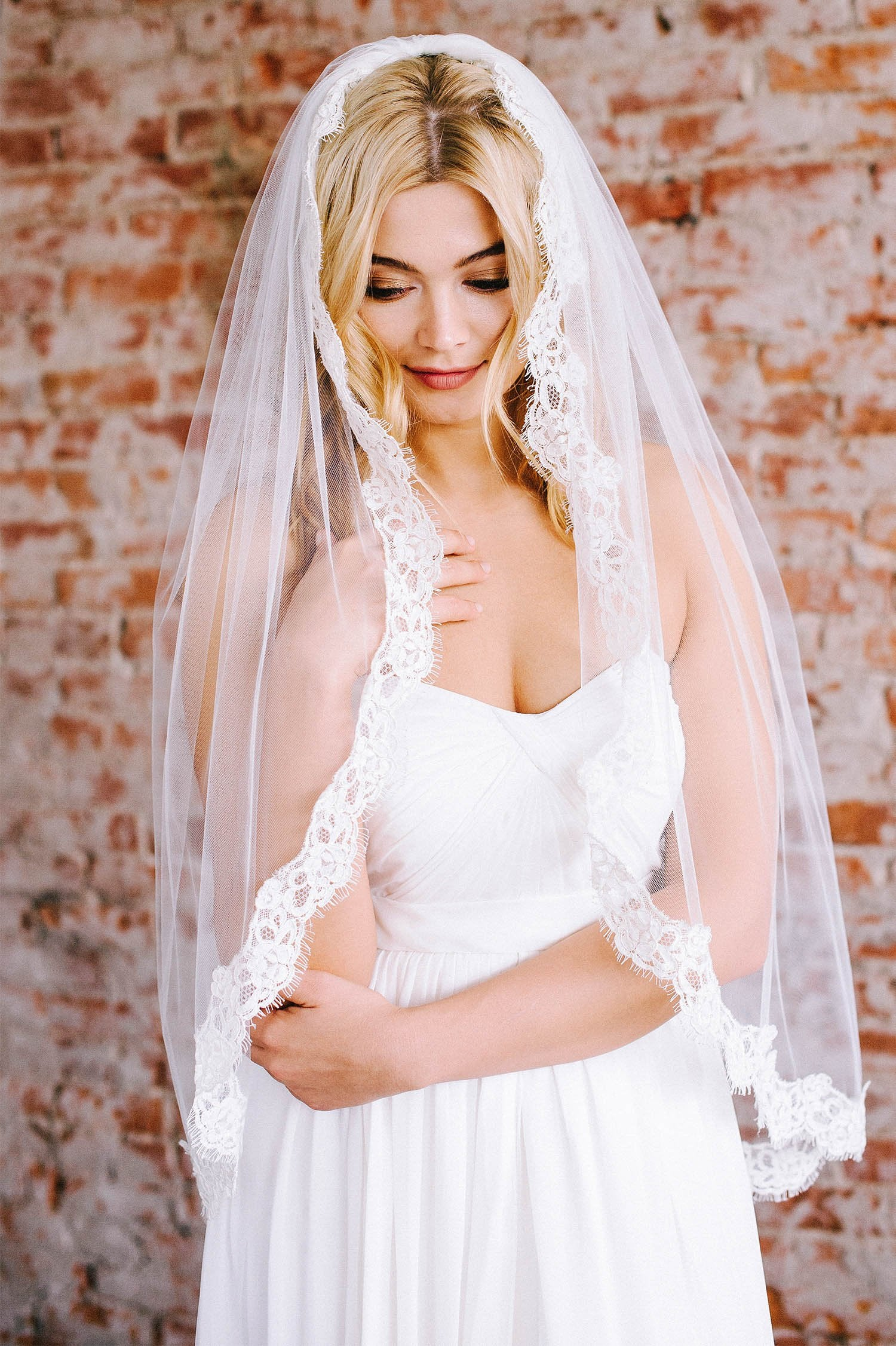 French lace fingertip bridal veil