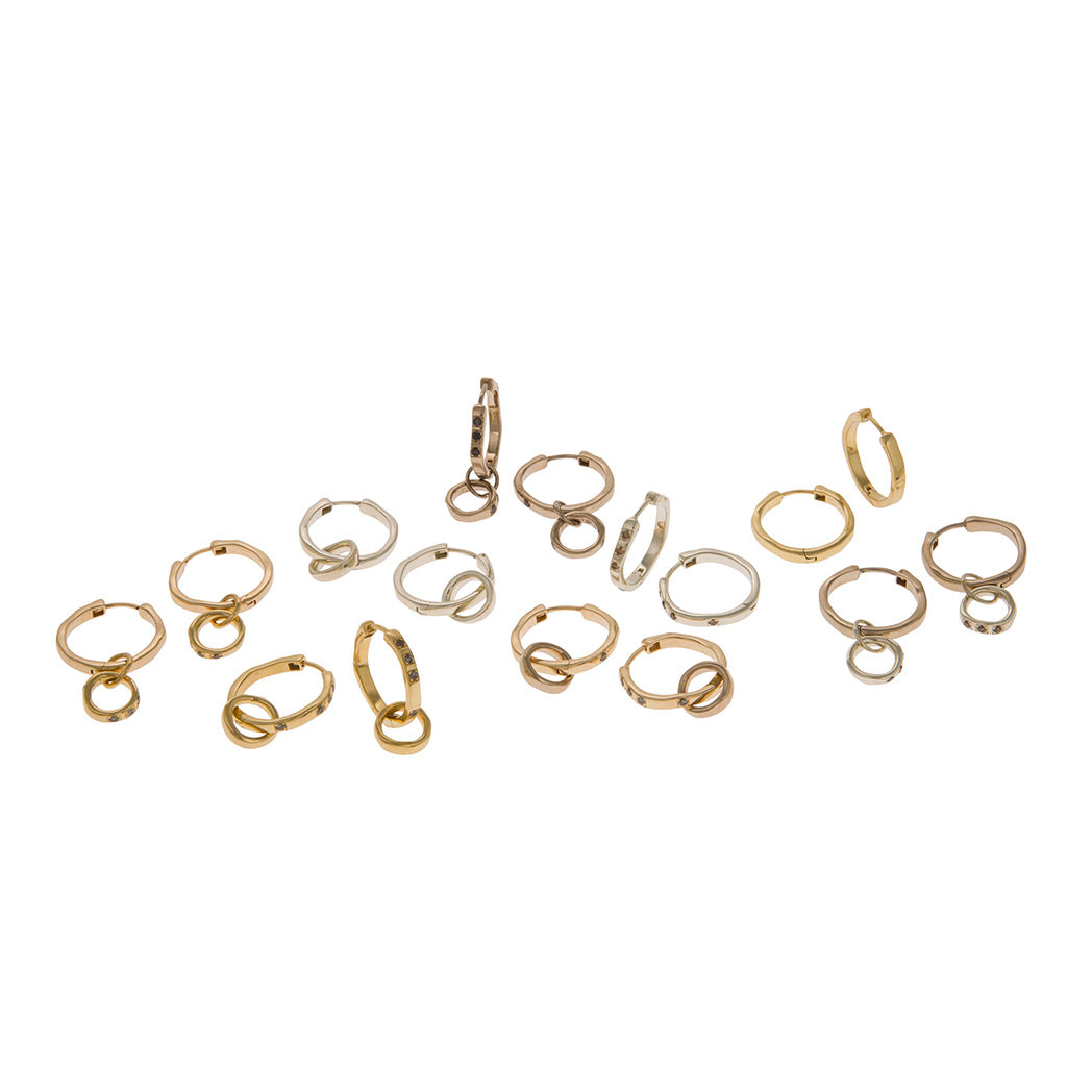 Unsymmetrical organically shaped handmade Hoop Earrings in 9carat 9ct 9k yellow and white gold, 18 carat 18ct 18k yellow and white gold, 9 carat yellow gold with grey diamonds, 9 carat white gold with brown diamonds, 18 carat yellow gold with grey diamonds, 18 carat white gold with black diamonds