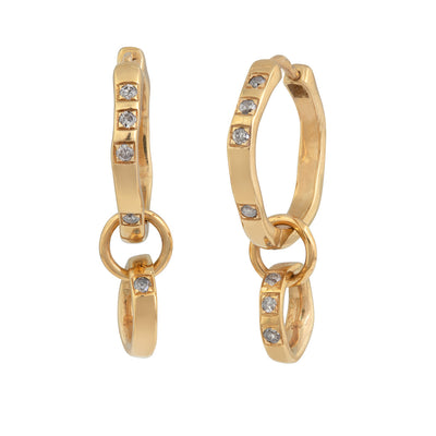 Classic, Twisted Hoop Earrings in Gold. The Classic Twist circles can be purchased plain or with diamonds. All diamonds are set in pave style framed in a squared line: three diamonds sit together on one side and one diamond on the opposite side. All diamonds are natural in colour and available in black, grey or brown, depending on the metal. The earrings come in White Gold, Yellow Gold, 18K and 9K Gold.