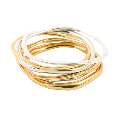 handmade ethical jewellery. organic styled thick bangle in silver and gold plated silver.  Edit alt text