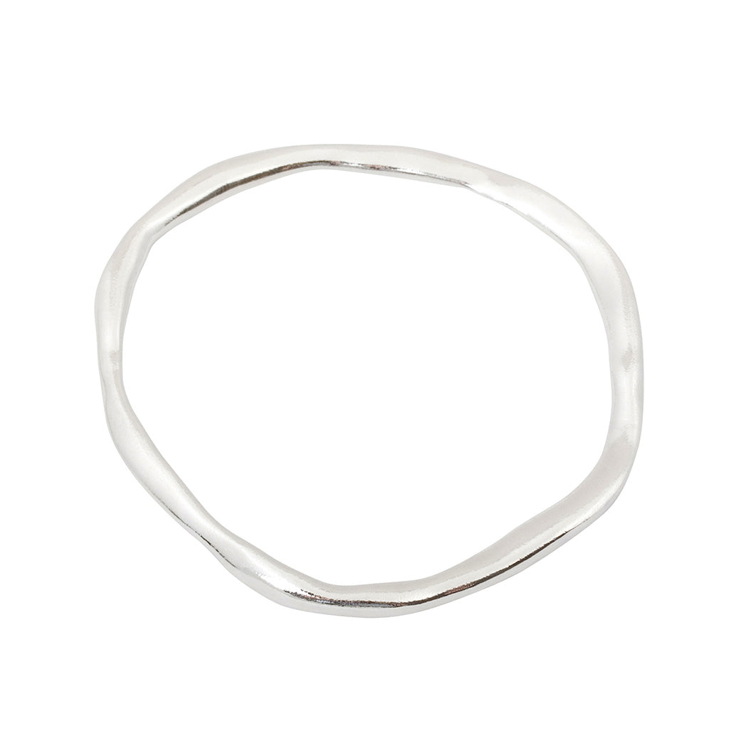 handmade contemporary organic shaped bangle in starling silver.made in london.  Edit alt text