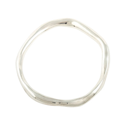 unusual organic shaped thick bangle in starling silver for sustainable fashion made in london  Edit alt text