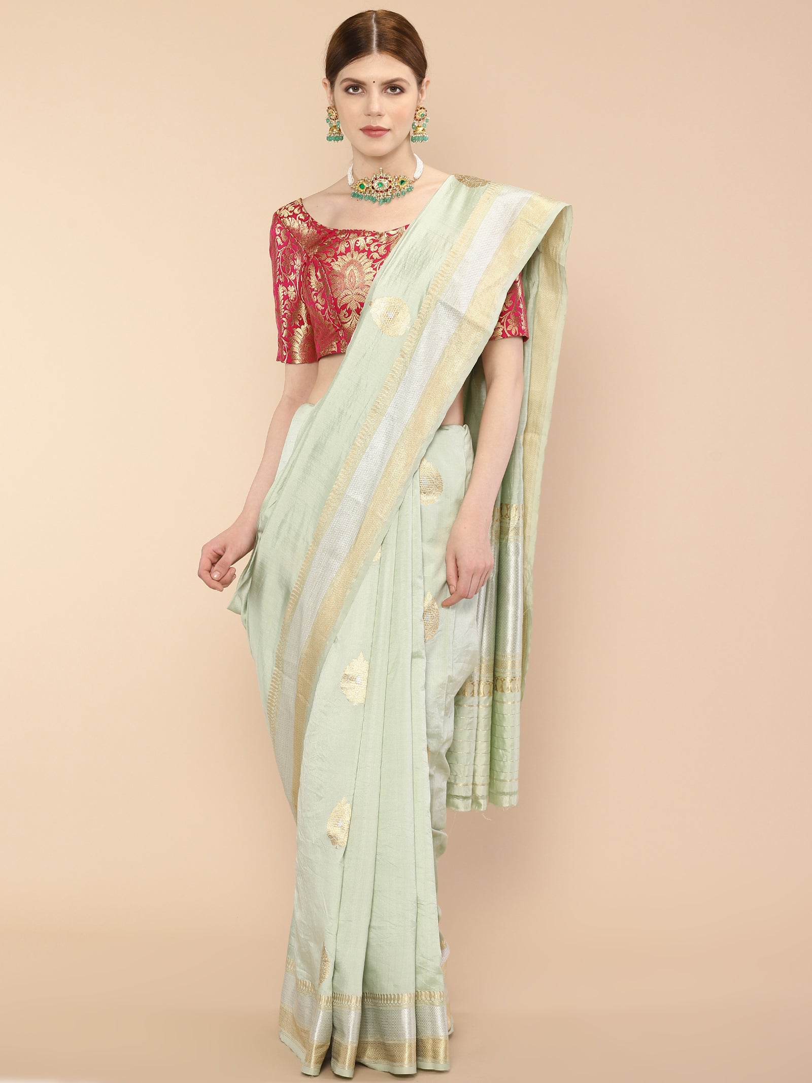 A pale blue pure silk banarasi saree is handwoven with leaf motifs and golden & silver zari borders.