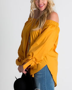Gathered off-the-shoulder tassel tie long sleeve blouse