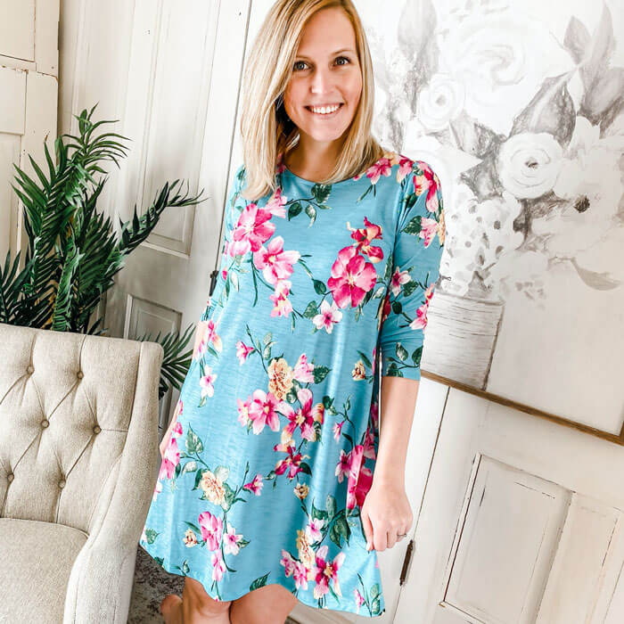 woman smiling in blue floral dress