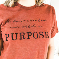created with a purpose red tee