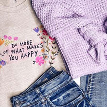 Purple sweater, jeans, and a graphic tee