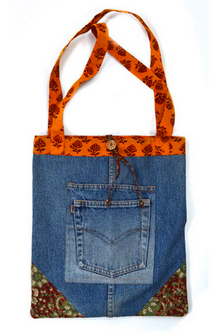 Upcycled denim tote bag with hand-block printed cotton straps and interior
