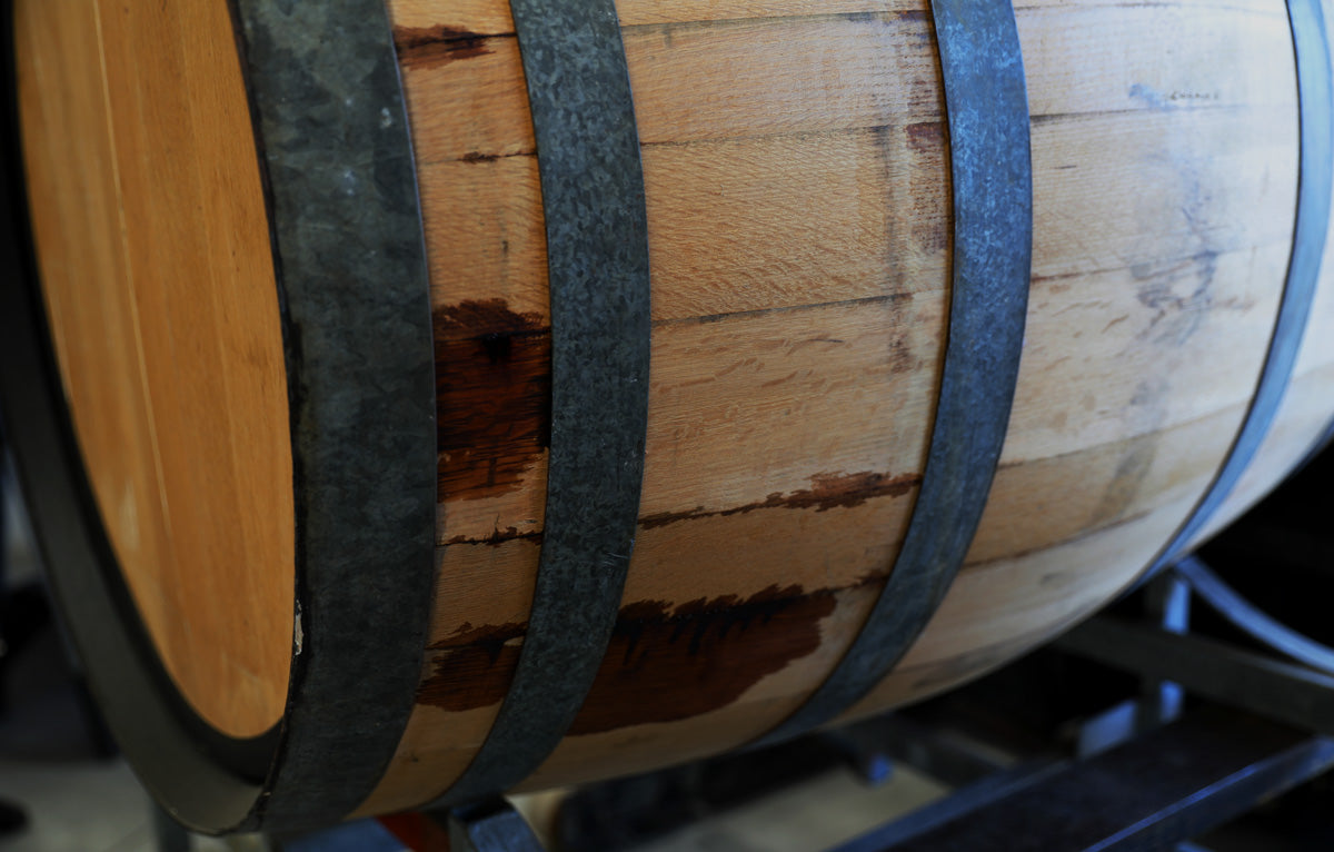 25 year old oak barrels from the Barossa Valley are used to age and mature Original Spirit Co.'s Harvest Blend EXQ