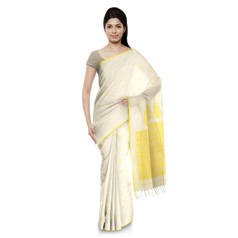 White  soft cotton saree with green and gold