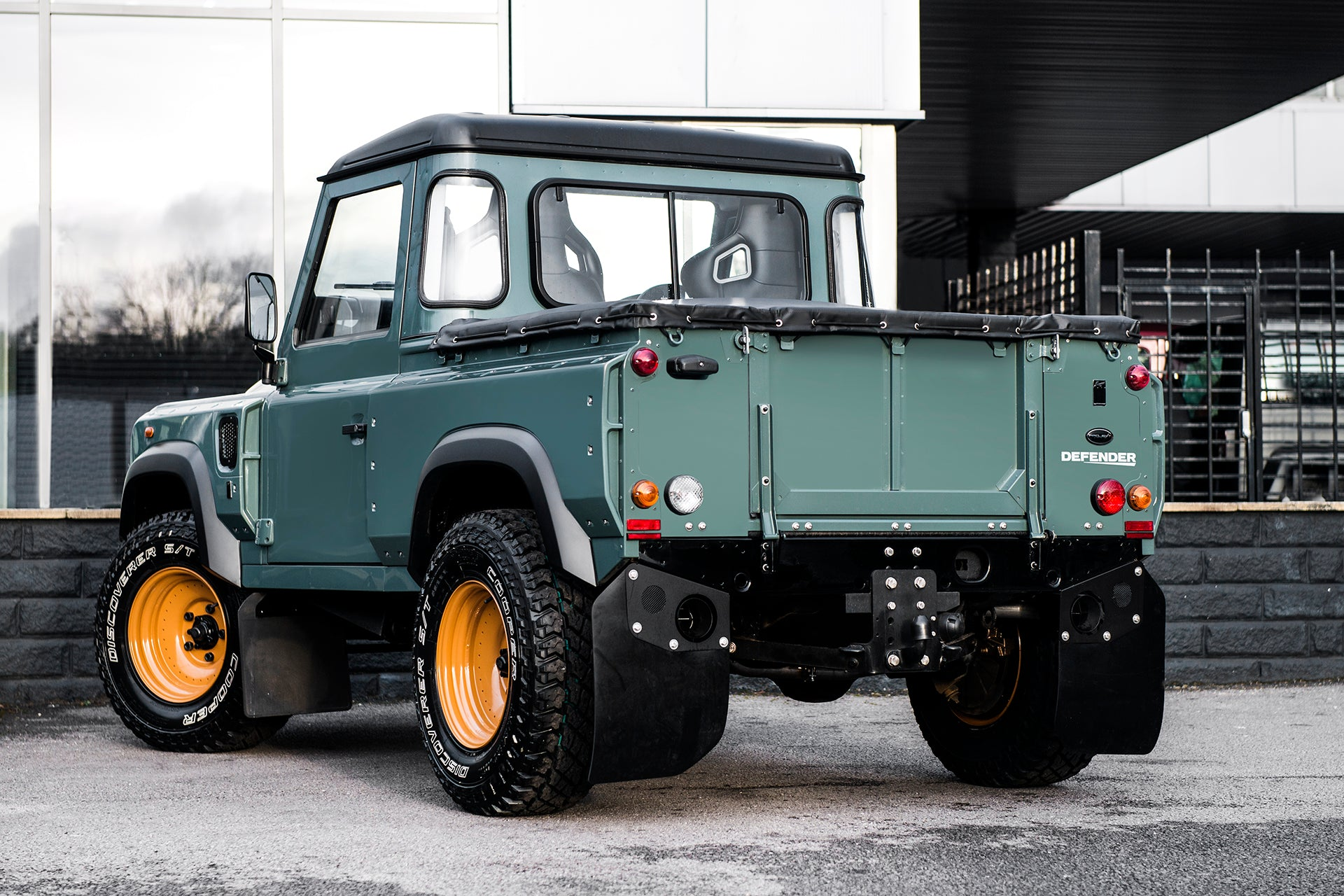 VIEW FROM THE SHOWROOM: LAND ROVER DEFENDER 90 PICK UP CHELSEA WIDE TRACK THE KESWICK GREEN